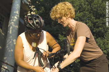 two people working on bike