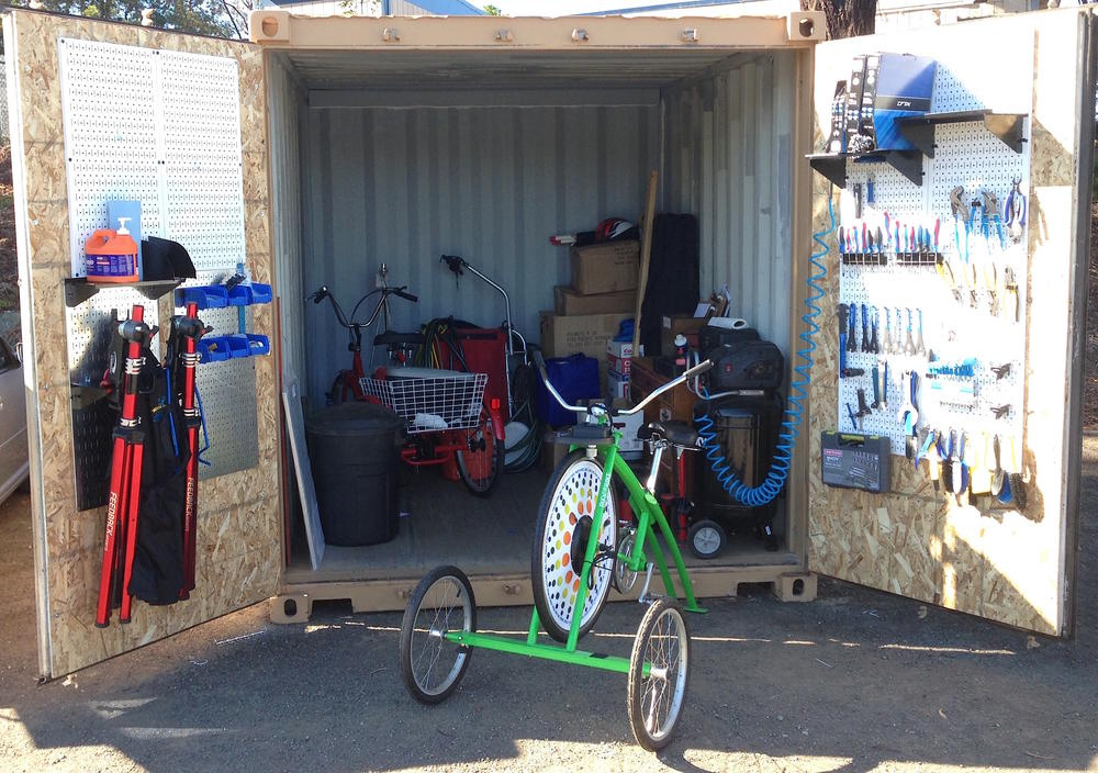 open shed with bike tools and parts