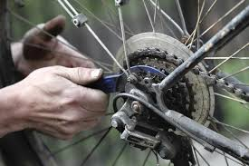 hands fixing bike