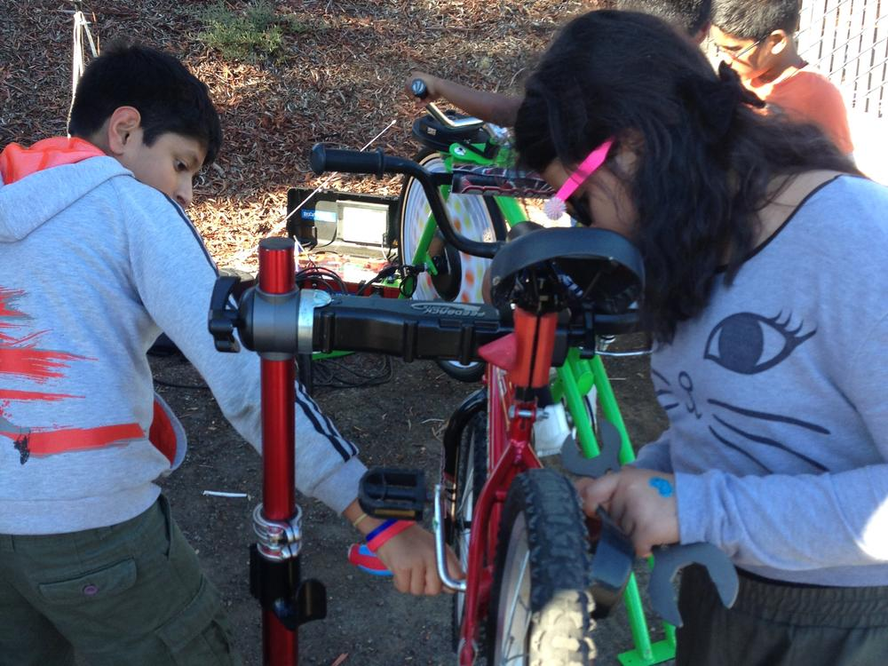 kids working on bikes